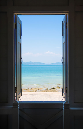 open the window ,blue sea ,blue sky , view background .Summer, Travel, Vacation and Holiday concept . Stock Photo