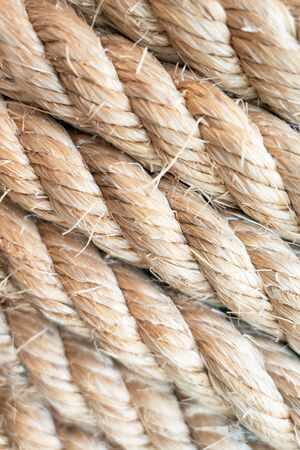 closeup brown strong nautical rope for background .