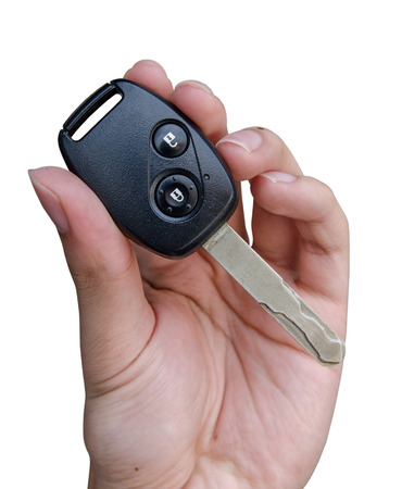remote access: Hand holding car keys isolated on white background Stock Photo