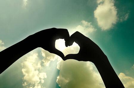 love shape hand silhouette in sky Stock fotó