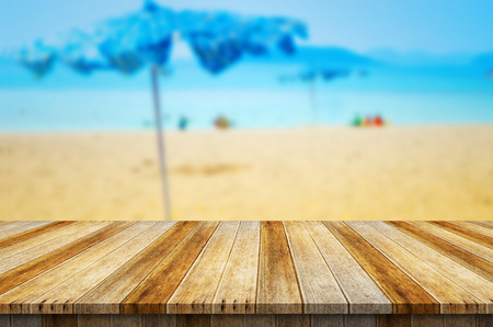 Empty wood table top on blurred blue sea background. Ready for product display montage.