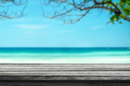 Empty wood table top on blurred branch and blue sea background. Ready for product display montage. Stock fotó