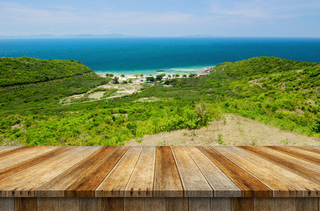 Empty wood table top on hill and blue sea background. Ready for product display montage. Imagens