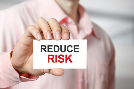 reduce risk: Reduce Risk text on the card in hand man.