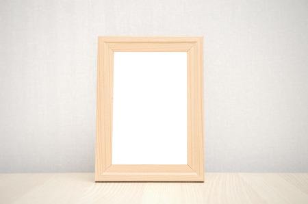 blank wood picture frame on the wall and the table wood
