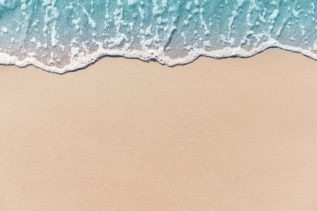 Close up soft wave lapped the sandy beach, Summer Background. Imagens