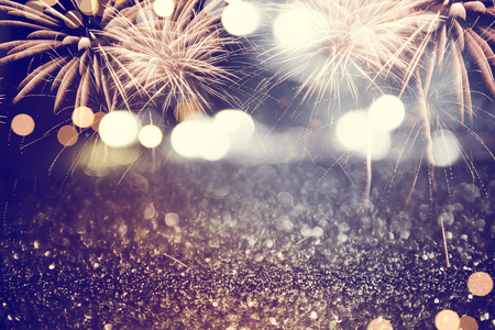 Gold and dark blue Fireworks and bokeh in New Year eve and copy space. Abstract background holiday.