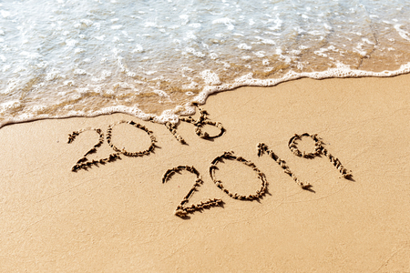 New Year 2019 replace 2018 on the sea beach concept Imagens