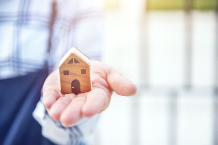 Woman hand holding new home.