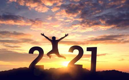 Silhouette young man jumping on the mountain and 2021 years while celebrating new year, happy victory and success concept. Standard-Bild