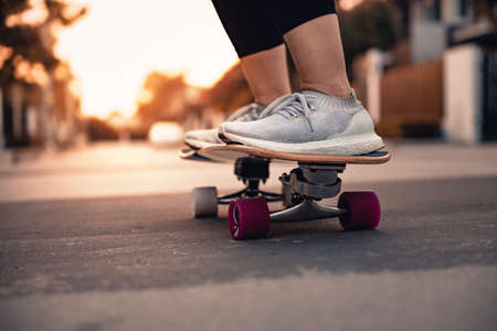 Close-up leg on surf skate on the road, Sport activity lifestyle concept, Healthy and exercise.