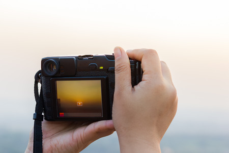 sunsets: Photographers are shooting sunsets. Stock Photo
