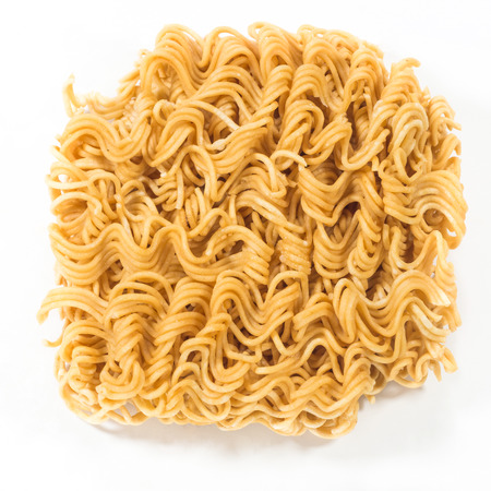 china cuisine: A block of dried Instant noodles isolated on a white background