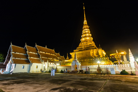 buddhist structures: Phra That Chae Haeng temple in day before the Buddhist Lent, nan, thailand Stock Photo