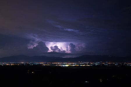 Lightning storm over city, Chiang mai, Thailand