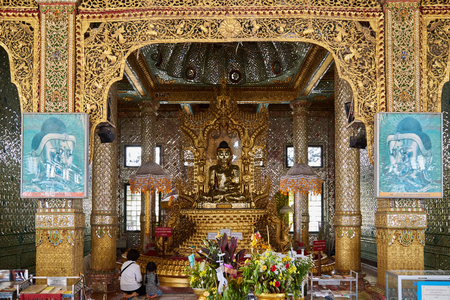 YANGON, MYANMAR - October 17, 2016: The interior of the Botataung Pagoda (literally: 1000 soldiers), the famous complex in Yangon, Burma. It was completely destroyed during World War II. Editorial