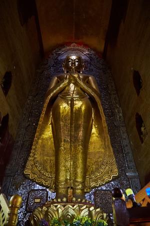 Buddha inside Ananda temple, Bagan, Myanmar.