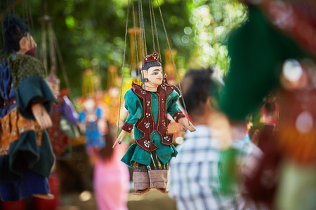 Traditional Burmese puppets hanging on display outside the Dhammayangyi Temple, Bagan Myanmar (Burma)