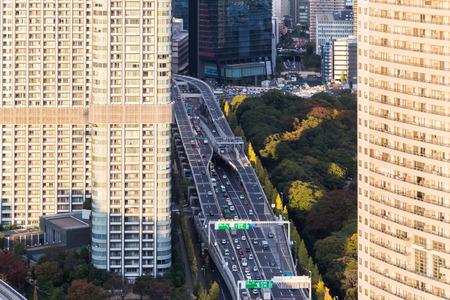 TOKYO, JAPAN - NOV 16, 2017: Passenger cars and buses running on Metropolitan Expressway Tokyo