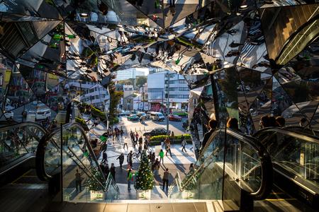 Tokyo, JAPAN - 17 November 2017 : Famous mirror escalator at Tokyo Plaza Omotesando Harajuku in Tokyo. Reflection mirror Editorial