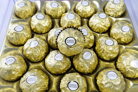 ferrero: Bangkok Thailand- FEBRUARY 07, 2016: Ferrero Rocher is a chocolate sweet made by Italian Ferrero Spa. Rocher comes from French and means rock after a grotto in the Roman Catholic shrine of Lourdes.