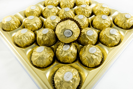 ferrero: Bangkok Thailand- FEBRUARY 10, 2016: Ferrero Rocher is a chocolate sweet made by Italian Ferrero Spa. Rocher comes from French and means rock after a grotto in the Roman Catholic shrine of Lourdes ideal for a gift valentines day
