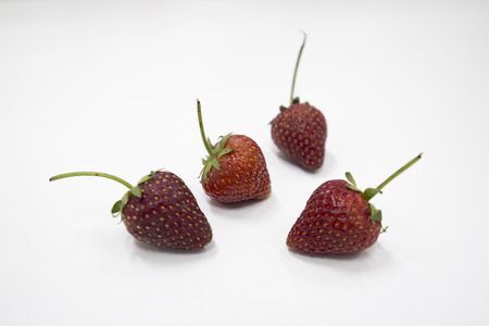 clustered: Strawberry close up on white background Stock Photo