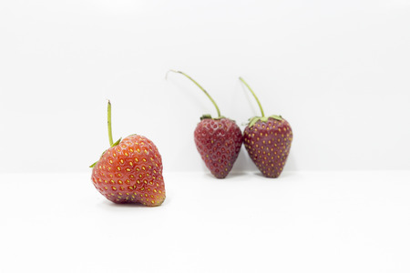 a faction: Strawberry close up on white background Stock Photo