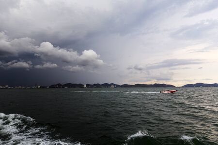 Two moods of the sky view of the sea ferry go to ko lan nearly bangkok thailand Stock Photo