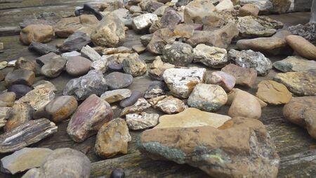 rocks on wooden table Banco de Imagens