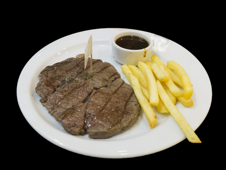 steak, fried and sauce in a white dish Stockfoto