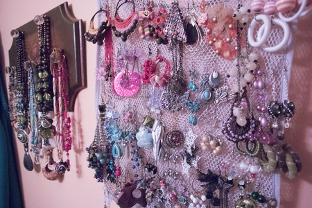 earrings and necklaces hainging on the wall from near to far view