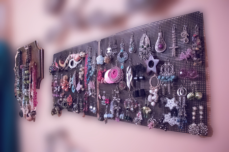 earrings and necklace hanging on the wall from near to far view Stockfoto
