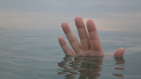 human hand up in water