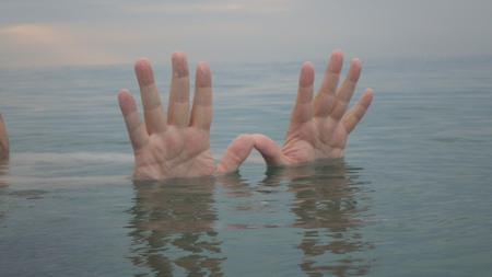human hands up in water Stockfoto