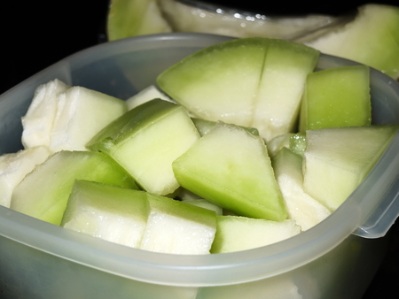 slices honey dew in a container
