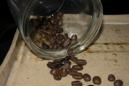 coffee bean in  a jar pouring