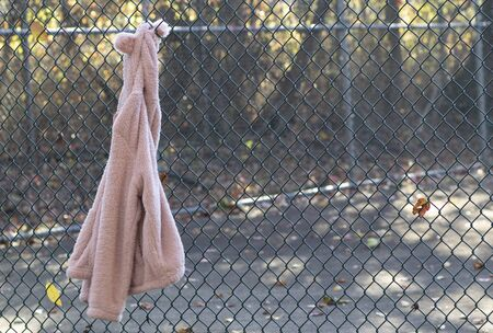 jacket hangs on the fence