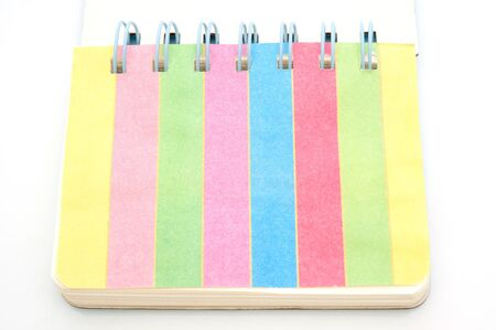 bound: An open spiral bound notebook color full