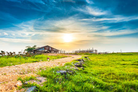 outbuilding: Old barn at sunset, Thailand