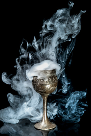 Wine goblet with smoke on black background 免版税图像