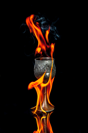 chalices: Wine goblet with Fire flames on black background
