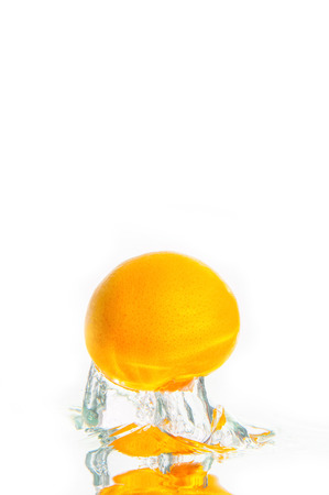 dropped: Fresh oranges dropped into water