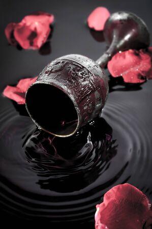 goblet: Wine goblet on water background