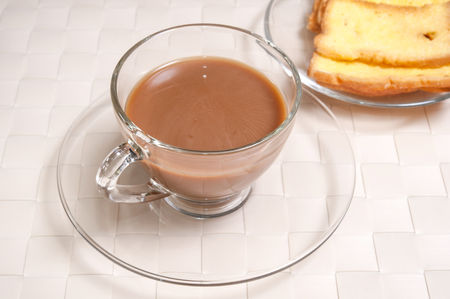 caf: Toasts butter with a cup of coffee