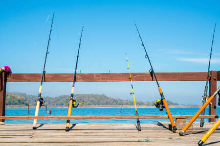 deep sea fishing: Fishing Poles with River Background