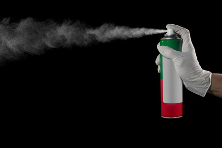 Hand and finger pushing spray can of insecticide