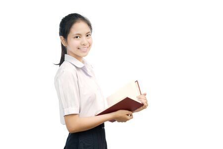 portrait of an Asian student holding Notebook on white background Stock Photo