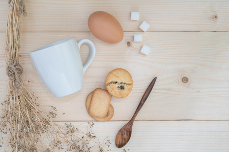pasteurized: Cookies with a glass of milk with spoon with egg and sugar on sackcloth Vintage Style Stock Photo