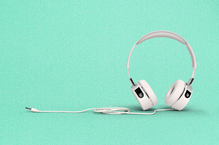 Headphone on paper background with clipping path and copy space for your text. Stock Photo
